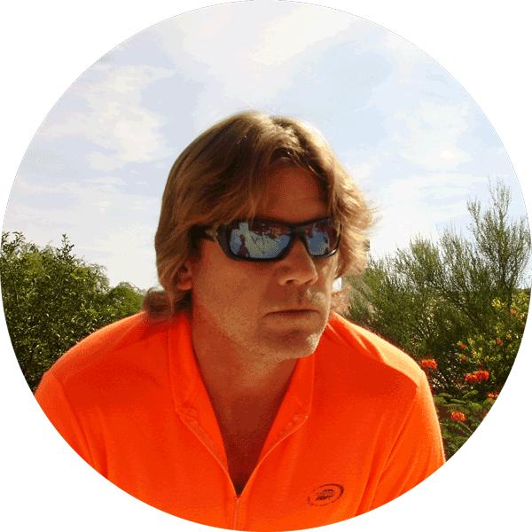 Mark-Unger-in-Orange-Shirt-and-Glasses